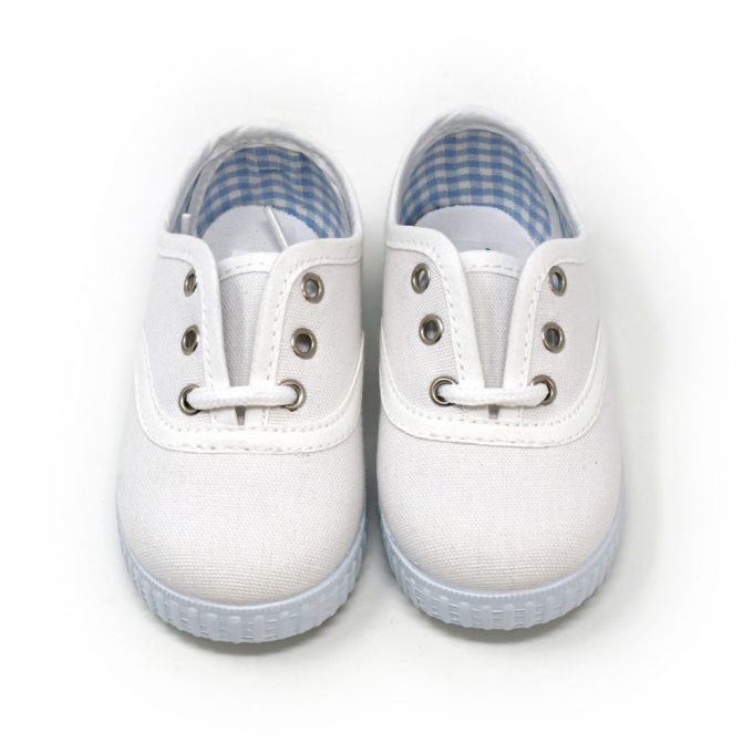 Zapatilla inglesita de lona color blanco con cordones. Niño y niña