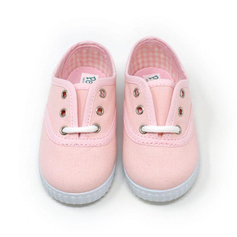 Zapatilla inglesita de lona color rosa con cordones. Niño y niña